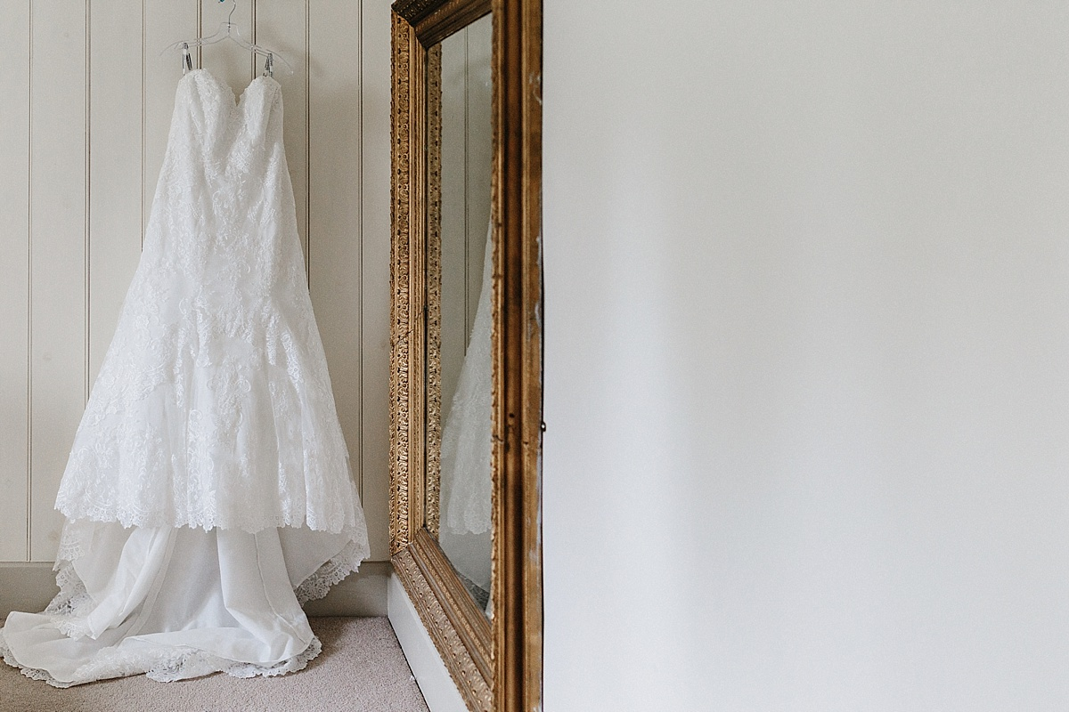 Wedding dress hanging up in Pim Hill Barn