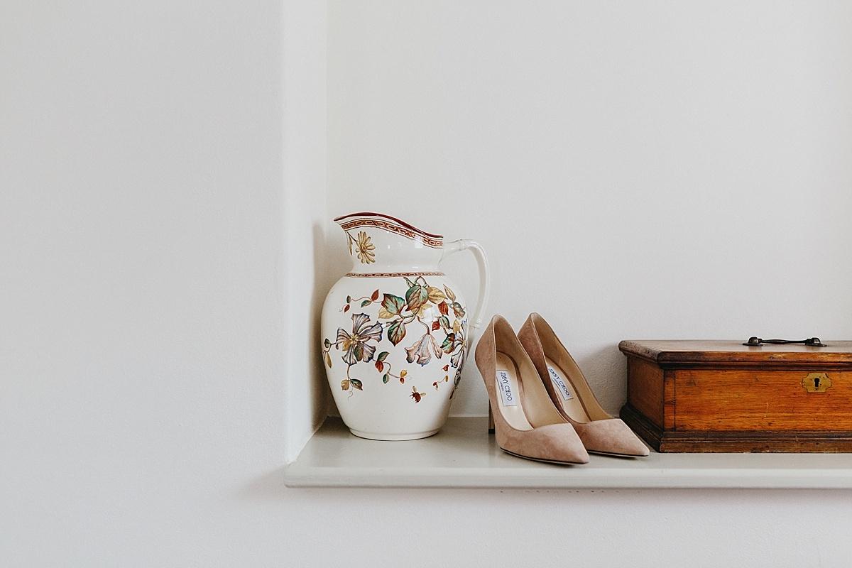 Pink Jimmy Choo shoes on shelf