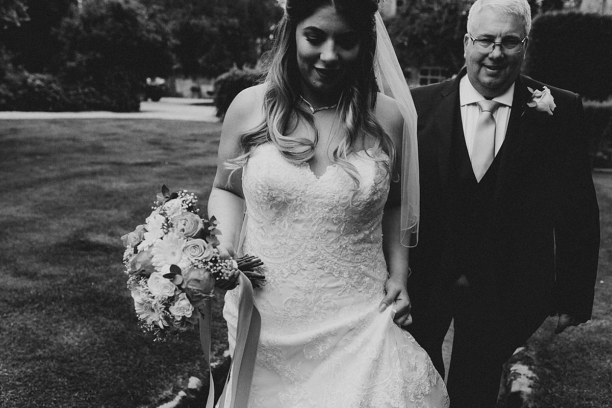 Bride and father walking to ceremony at Pim Hill Barn, Shropshire