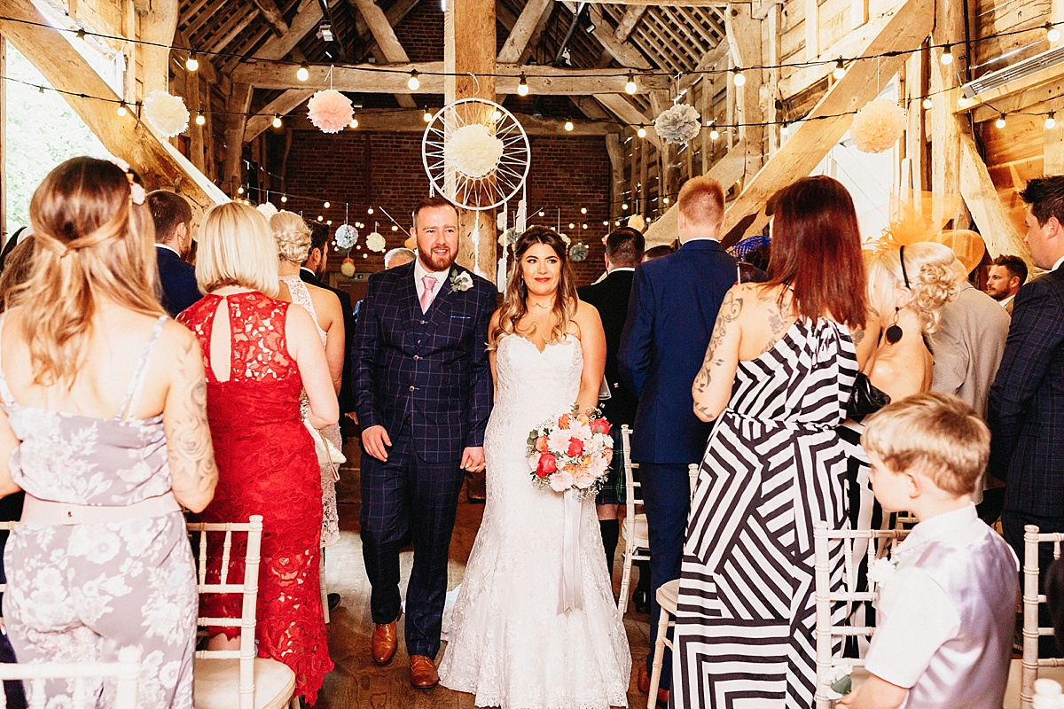 Bride and Groom recessional at Pim Hill Barn, Shropshire