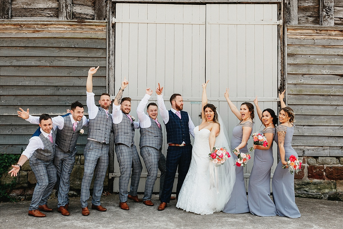 Bridesmaids and Groomsmen outside Pim Hill Barn