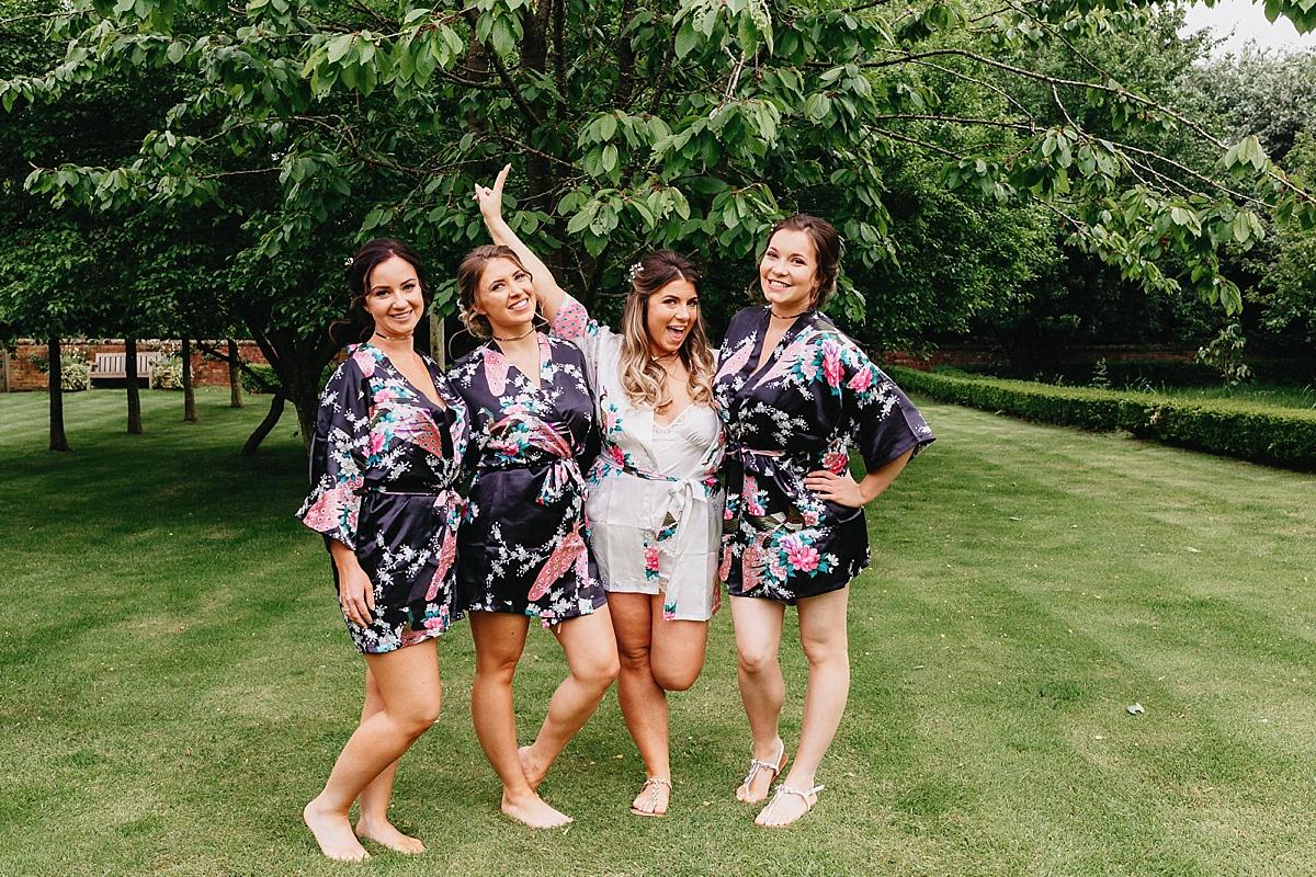 Bridesmaids in kimonos at Pim Hill Barn