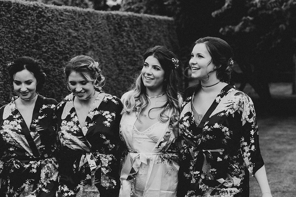 Bridesmaids walking at Pim Hill Barn